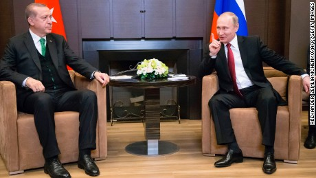 Recep Tayyip Erdogan (L) meets with Vladimir Putin in Sochi on Wednesday.