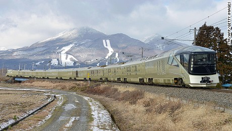 This picture taken on December 11, 2016 shows the Train suite Shiki-Shima, operated by East Japan Railway, during a training run in Inawashiro, Fukushima prefecture. The luxury sleeper Shiki-Shima, which can accommodate up to 34 passengers, has 10 cars, including a lounge car, a dining car and two observatory cars. The train has only 17 cabins, all suites, and the most expensive room, known as Shiki-Shima Suite, is priced at 950,000 yen (8480 USD) per person when shared by two people. / AFP PHOTO / JIJI PRESS / str / Japan OUT (Photo credit should read STR/AFP/Getty Images)