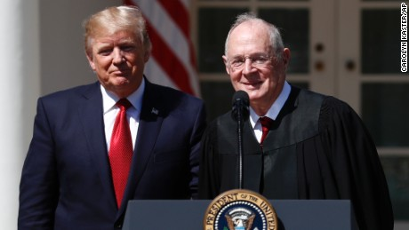 President Donald Trump, left, and Supreme Court Justice Anthony Kennedy participate in a public swearing-in ceremony for Justice Neil Gorsuch in the Rose Garden of the White House White House in Washington, Monday, April 10, 2017.