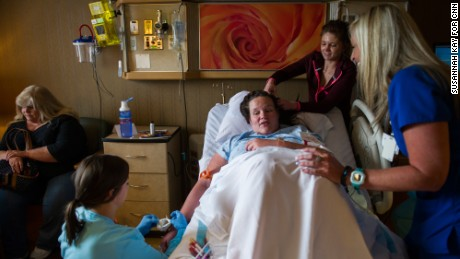 Jessica is surrounded by friends, family and hospital staff shortly before her C-section on April 20.