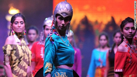 "Models take part in a fashion show to promote ""Baahubali 2"" in Mumbai in April."