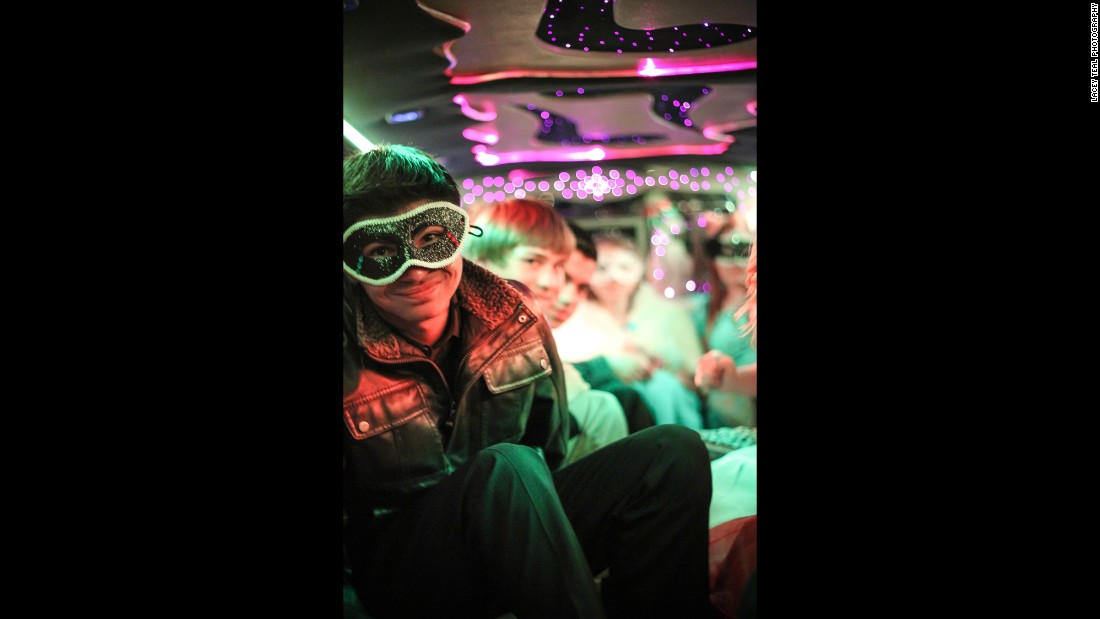 Special needs students from Pocatello High School relax in a limousine on their prom night.