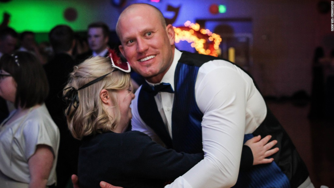 Special education teacher Christian Colonel dances with one of his students at prom.