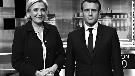 French presidential election candidate for the far-right Front National (FN) party, Marine Le Pen (L) and French presidential election candidate for the En Marche ! movement, Emmanuel Macron pose prior to the start of a live brodcast face-to-face televised debate in television studios of French public national television channel France 2, and French private channel TF1 in La Plaine-Saint-Denis, north of Paris, on May 3, 2017 as part of the second round election campaign. Pro-EU centrist Emmanuel Macron and far-right leader Marine Le Pen face off in a final televised debate on May 3 that will showcase their starkly different visions of France's future ahead of this weekend's presidential election run-off.  / AFP PHOTO / POOL / Eric FEFERBERG / ALTERNATIVE CROP         (Photo credit should read ERIC FEFERBERG/AFP/Getty Images)