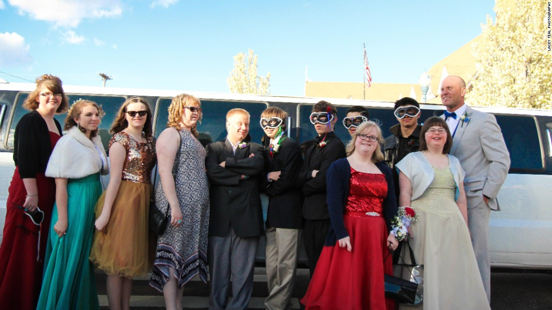 The 13 special needs students and their teacher at the start of their prom night.