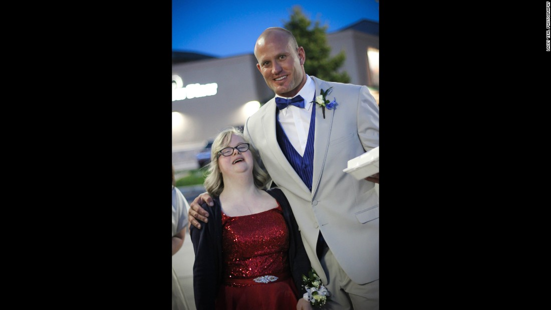 Special education teacher Christian Colonel with one of his students headed to prom.