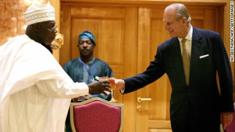 Prince Philip toasts then Nigerian President Olusegun Obasanjo in  Abuja, Nigeria in 2003.
