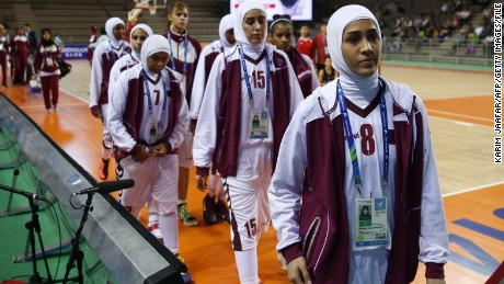 Qatar's women's basketball team walks off court after withdrawing from its 2014 Asian Games match with Mongolia