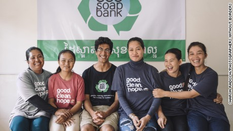 Lakhani shares a light moment with staff at Eco-Soap Bank--which employs local women