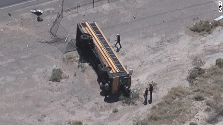The bus turned over after colliding with another vehicle.