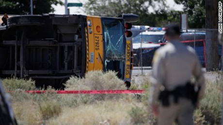 Authorities investigate a school bus crash Thursday in Las Vegas.