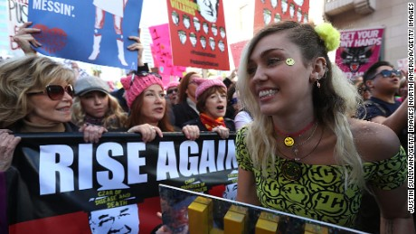 Singer Miley Cyrus (R) marches during the Women's March on January 21, 2017 in Los Angeles, California.