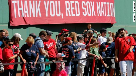 Fans line up to meet Boston Red Sox players at Fenway Park in Boston.