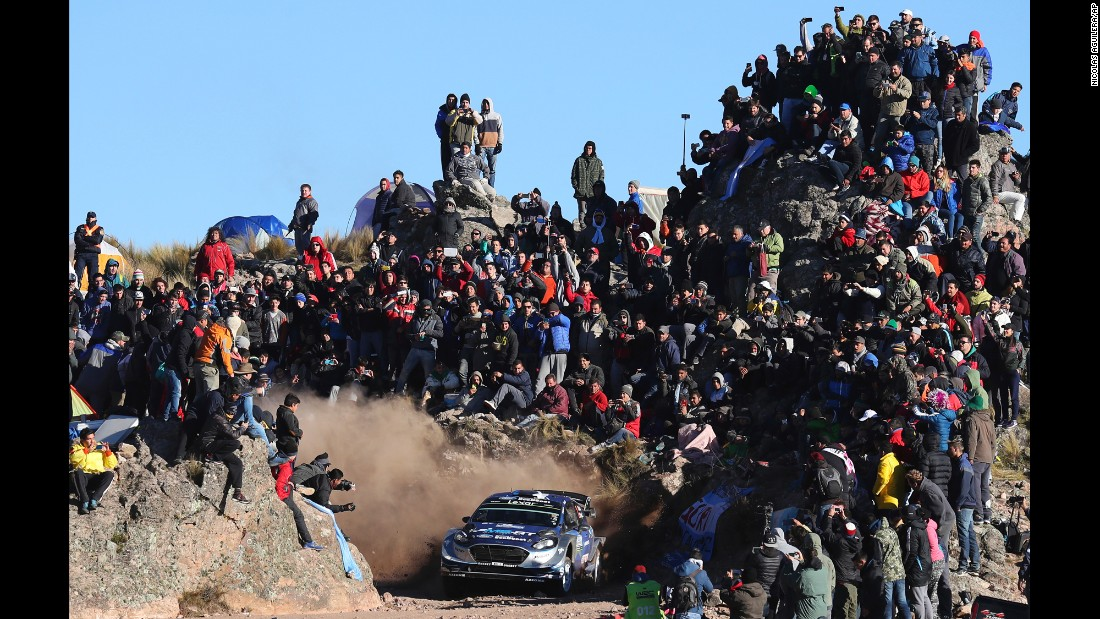 People in El Condor, Argentina, watch the rally car of Estonian driver Ott Tanak during a race on Sunday, April 30.