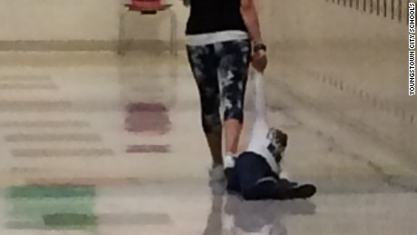 An Ohio Head Start teacher was fired after a colleague snapped this photo of the woman dragging a young student down a hallway Tuesday.
