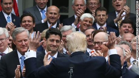 WASHINGTON, DC - MAY 04:  U.S. President Donald Trump (C) congratulates House Republicans after they passed legislation aimed at repealing and replacing ObamaCare, during an event in the Rose Garden at the White House, on May 4, 2017 in Washington, DC. The House bill would still need to be passed by the Senate before it could be signed into law. (Photo by Mark Wilson/Getty Images)