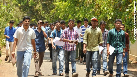 Students coming out of the exam centre after appearing in the JEE (Advanced) exam at Siddhartha Mahila Kalasala in Vijayawada on Sunday. 101Reporters