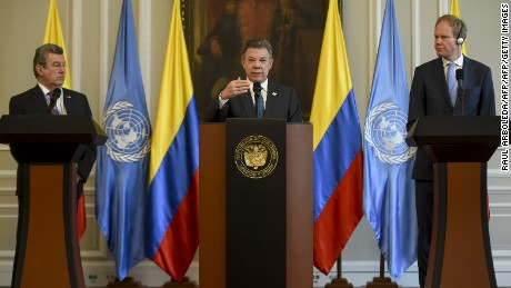 Colombian President Juan Manuel Santos (C) speaks next to Uruguay's ambassador at the United Nations Elbio Rosselli (L) and Great Britain's Ambassador at the UN Matthew Rycroft during a meeting at Narino Palace in Bogota on May 4 2017.  The United Nations Security Council in full arrived Thursday to Colombia to meet with President Juan Manuel Santos, to express support for the implementation of peace agreements in Colombia and to study the progress of the special mission established In the country by the UN. / AFP PHOTO / RAUL ARBOLEDA        (Photo credit should read RAUL ARBOLEDA/AFP/Getty Images)