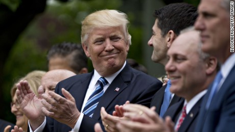 U.S. President Donald Trump, center, applauds while standing next to U.S. House Speaker Paul Ryan, a Republican from Wisconsin, center right, during a press conference in the Rose Garden of the White House in Washington, D.C., U.S., on Thursday, May 4, 2017. House Republicans mustered just enough votes to pass their health-care bill Thursday, salvaging what at times appeared to be a doomed mission to repeal and partially replace Obamacare under intense pressure from Trump to produce legislative accomplishments. Photographer: Andrew Harrer/Bloomberg via Getty Images