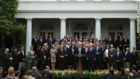 President Donald Trump speaks on May 4 while flanked by House Republicans after they passed health care legislation.