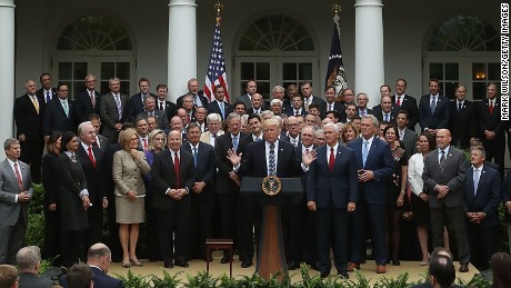 President Donald Trump speaks while flanked by House Republicans after they passed legislation aimed at repealing and replacing Obamacare during an event Thursday in the Rose Garden.