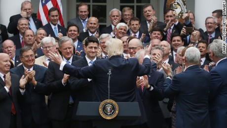President Donald Trump congratulates House Republicans at a recent White House event after they passed a bill aimed at  replacing ObamaCare.