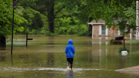 A child walks in his flooded neighborhood Thursday in Arnold, Missouri.