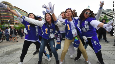 Supporters of South Korean presidential candidate Moon Jae-In of the Democratic Party dance during an election campaign in Goyang city, northwest of Seoul.