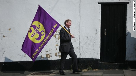 A UK Independence party supporter carries a party flag as leader Paul Nuttall visits Hartlepool on April 29, 2017 in Hartlepool, United Kingdom.