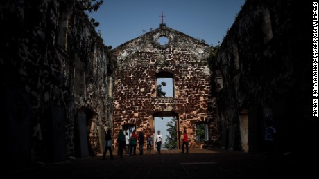 In this picture taken on September 3, 2015 tourists visit the 16th century St Pauls church in Malaysia's historical city of Malacca. The Portuguese were the first to arrive in the historical port city of Malacca in the 15th century and ruled for 130 years, before the Dutch captured it in 1641. After almost 183 years they gave it up to the next colonial rulers, Britain. Malacca was declared a UNESCO world heritage city in 2008.     AFP PHOTO / MANAN VATSYAYANA        (Photo credit should read MANAN VATSYAYANA/AFP/Getty Images)