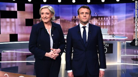 French presidential election candidate for the far-right Front National (FN) party, Marine Le Pen (L) and French presidential election candidate for the En Marche ! movement, Emmanuel Macron pose prior to the start of a live brodcast face-to-face televised debate in television studios of French public national television channel France 2, and French private channel TF1 in La Plaine-Saint-Denis, north of Paris, on May 3, 2017 as part of the second round election campaign. Pro-EU centrist Emmanuel Macron and far-right leader Marine Le Pen face off in a final televised debate on May 3 that will showcase their starkly different visions of France's future ahead of this weekend's presidential election run-off.  / AFP PHOTO / POOL / Eric FEFERBERG        (Photo credit should read ERIC FEFERBERG/AFP/Getty Images)