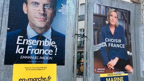 Election posters outside Beziers' town hall is seen with Macron's eyes scratched out.