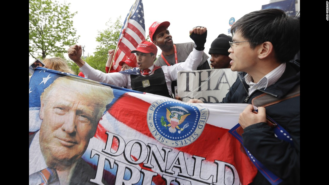 Trump supporters gather near the USS Intrepid before the gala in New York on Thursday, May 4. The gala marked the 75th anniversary of the Battle of the Coral Sea, a key World War II moment in which the American and Australian navies stopped Japanese advancement in the Pacific.