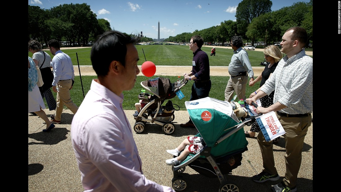 "Parents push their children in strollers during a ""Strolling Thunder"" event in Washington on Tuesday, May 2. The event was designed to urge Congress to support policies that focus on young children and allow them to fulfill their potential."