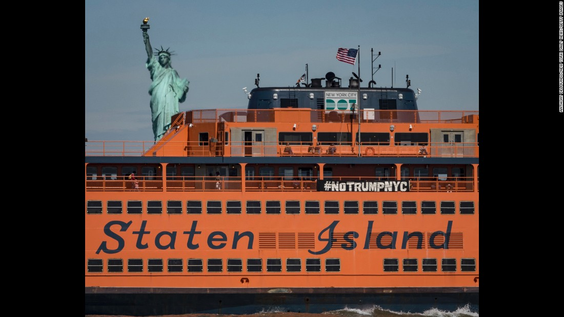 "Activists hang an anti-Trump banner from the Staten Island Ferry on Thursday, May 4. The President was making <a href=""http://www.cnn.com/2017/05/03/politics/donald-trump-new-york-city/"" target=""_blank"">his first trip to New York</a> since his inauguration."