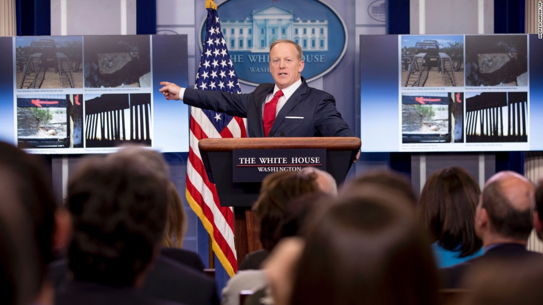 "White House press secretary Sean Spicer points to sections of different border walls during a briefing on Wednesday, May 3. The White House says it's going to build a wall along the US-Mexico border with new funding appropriated by Congress. <a href=""http://www.cnn.com/2017/05/03/politics/chain-link-fence-not-the-border-fence/"" target=""_blank"">But the improvements planned to existing fences</a> are nothing that past administrations haven't done."