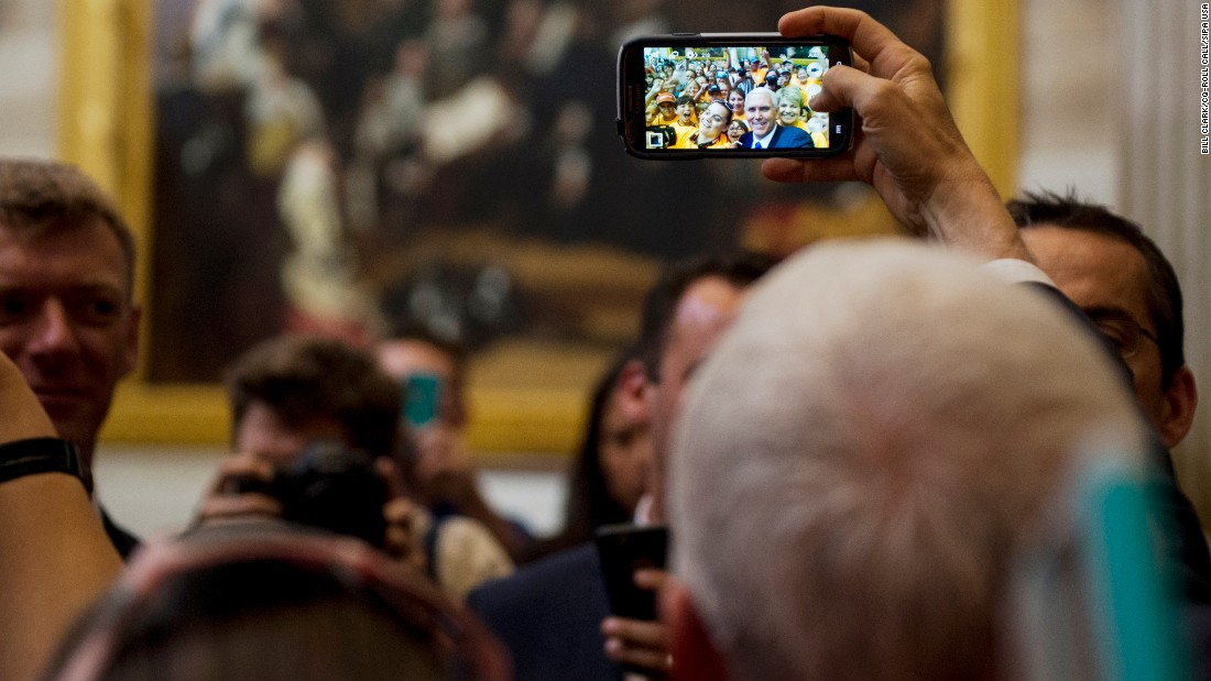 Vice President Mike Pence takes a selfie with a school group at the US Capitol on Tuesday, May 2.