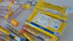 Merilee Hufnagel keeps her family's expired EpiPens as backups.