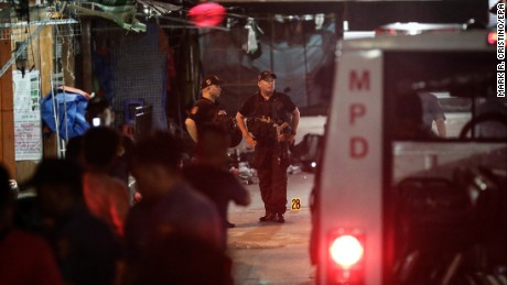 Authorities investigate the scene of a blast Saturday in Manila.