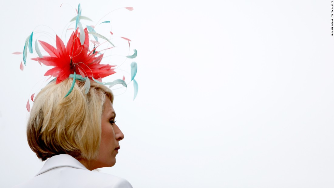 A woman watches an early race before the 143rd Kentucky Derby.