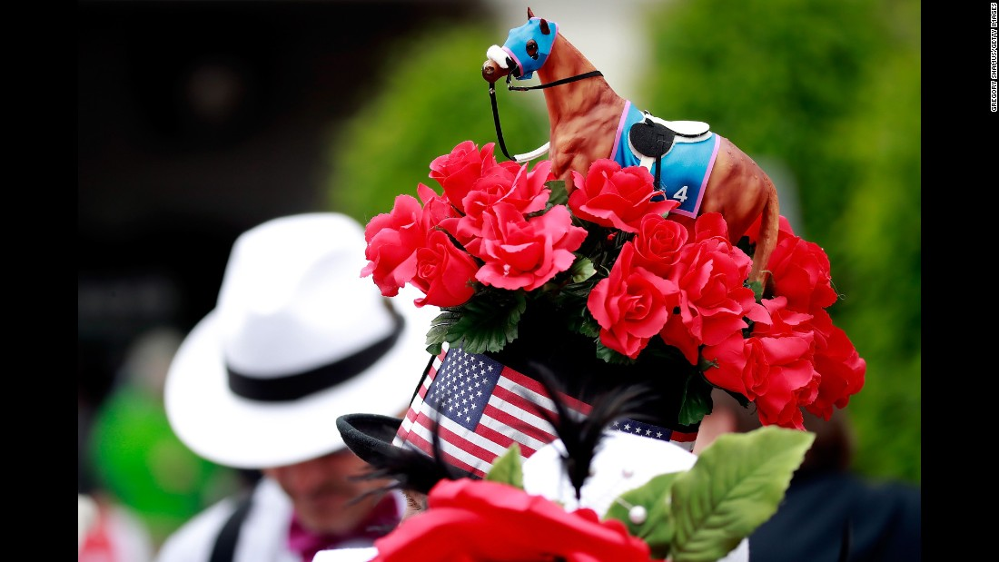 A small racehorse figure sits atop a man's hat at the 143rd Kentucky Derby at Churchill Downs on Saturday, May 6, in Louisville.