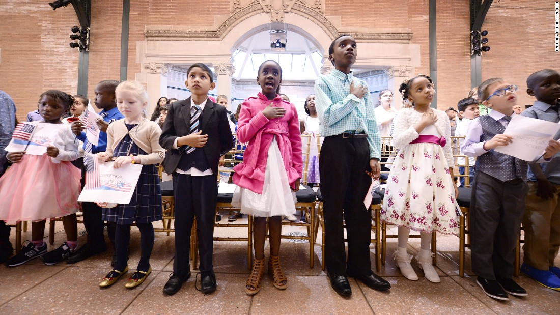 "Children recite the national anthem before the start of a citizenship ceremony in New York on Friday, May 5. Thirty-two children, ranging in age from 5 to 13 years old, attended the ceremony and <a href=""http://www.nydailynews.com/new-york/bronx/u-s-swears-in-32-kids-american-citizens-bronx-zoo-article-1.3140940"" target=""_blank"">became US citizens.</a>"