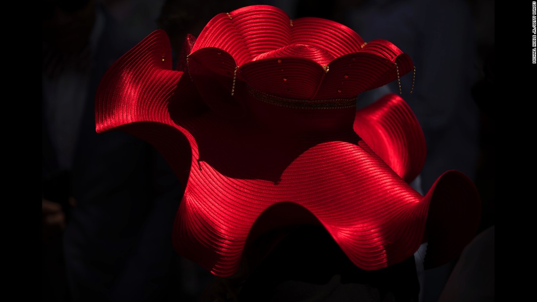 A hat is illuminated by the sun as attendees watch the red carpet arrivals.