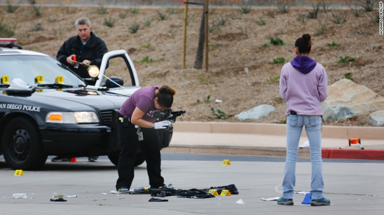 San Diego Police Department officers collect evidence at the scene of a fatal officer-involved shooting of a 15-year-old boy.