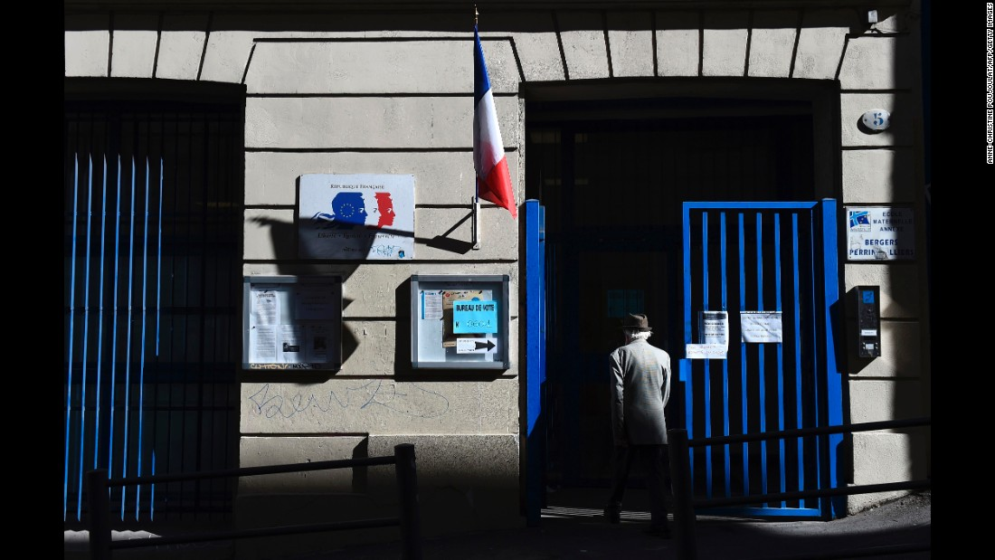 A voter arrives at a polling station in Marseille, France, on Sunday, May 7.