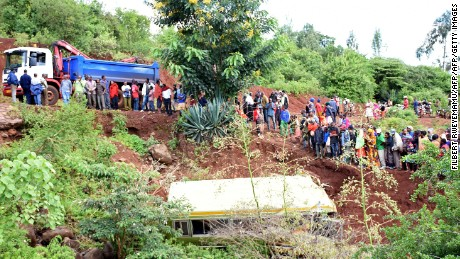 People look at the wreckage of a bus crash in Tanzania.