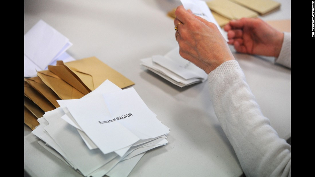 A polling official counts ballots on May 7 in Quimper, France.