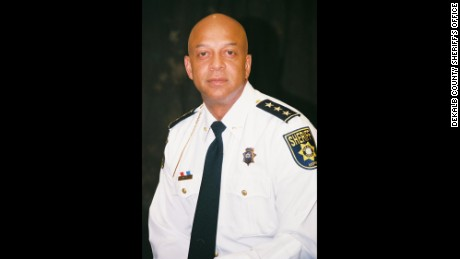 The suspension of DeKalb County Sheriff Jeffrey Mann is effective Tuesday.