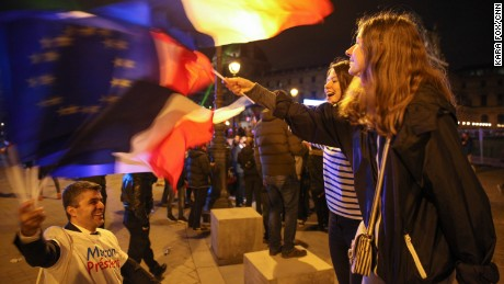 Parisians dance and cheer at the Macron victory rally on Sunday night.