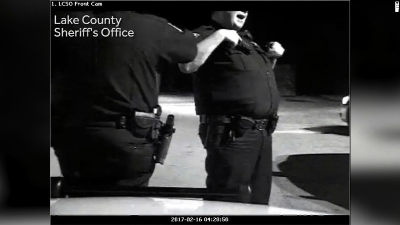 Dashcam video caught this image of Deputy Dean Zipes, right.